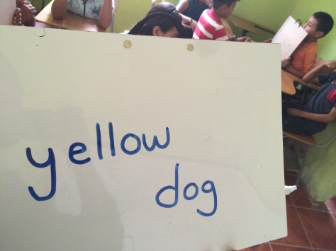 "I'd say ""Perro Amarillo"" and they'd have to write the English equivalent."