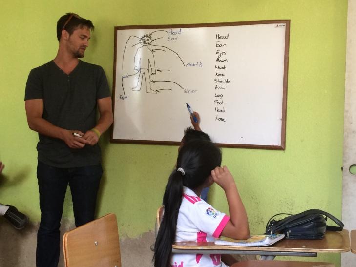 New volunteer Ben teaching body parts.